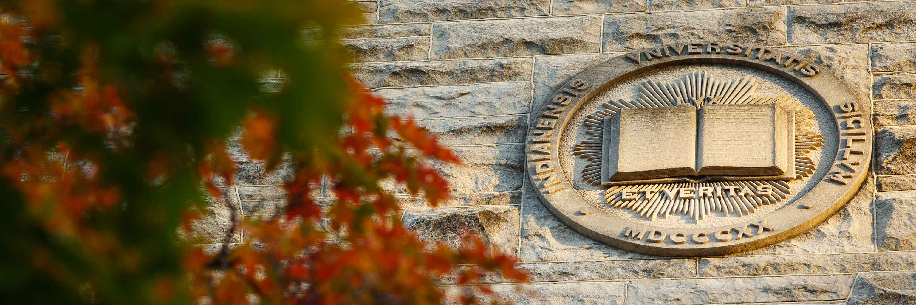 Indiana University seal carved into limestone